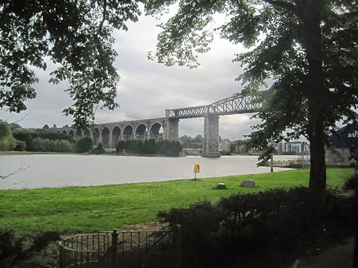 Image of a tall rail bridge over water.
